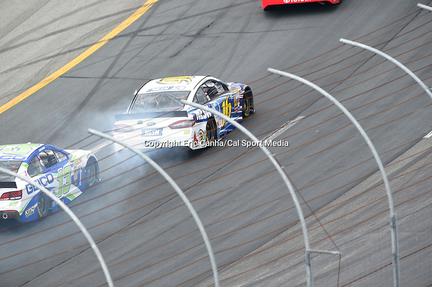July 13, 2014 - Loudon, New Hampshire, U.S. - Sprint Cup Series driver Greg Biffle (16) heads into turn 2 trailing smoke during the NASCAR Sprint Cup Series Camping World RV 301 race held at the New Hampshire Motor Speedway in Loudon, New Hampshire. Eric Canha/CSM