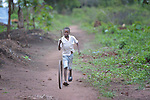 James John, 8, rolls a wheel along a path in a camp for more than 5,000 displaced people in Riimenze, in South Sudan's Gbudwe State, what was formerly Western Equatoria. Families here were displaced at the beginning of 2017, as fighting between government soldiers and rebels escalated.<br /> <br /> Two Catholic groups, Caritas Austria and Solidarity with South Sudan, have played key roles in assuring that the displaced families here have food, shelter and water.