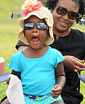 Twenty-one month old, Ayanna McCullough, with her mother, also named, Ayanna McCullough, in the audience at the 2014 Jazz in the Valley Festival held in Waryas Park on the Hudson River front in Poughkeepsie, NY on Sunday August 17, 2014. Photo by Jim Peppler. Copyright Jim Peppler 2014 all rights reserved.