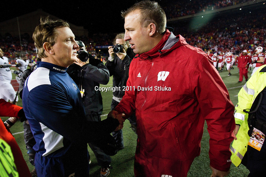 Wisconsin Badgers Head Coach shakes hands with Penn State Nittany Lions Tom Bradley after an NCAA Big Ten Conference college football game against the Penn State Nittany Lions on November 26, 2011 in Madison, Wisconsin. The Badgers won 45-7. (Photo by David Stluka)