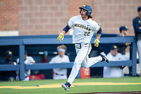 Michigan Wolverines first baseman Jordan Brewer (22) sprints towards home against the Western Michigan Broncos on March 18, 2019 in the NCAA baseball game at Ray Fisher Stadium in Ann Arbor, Michigan. Michigan defeated Western Michigan 12-5. (Andrew Woolley/Four Seam Images)