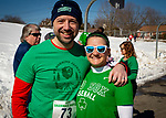 WATERTOWN,  CT-030919JS16--Jason and Kristina Boudreau of Woodbury, at the 8th annual Watertown Shamrock Shuffle Road Race at Polk Elementary School in Watertown. This year, proceeds from the event will benefit the Water-Oak Circle of Sports.<br /> Jim Shannon Republican American