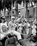 The 1997 Major League Baseball World Series Champions Florida Marlins have a parade in downtown Miami for the fans. The Marlins beat the Cleveland Indians. The Marlins won their first world series in only their fifth season as a team. Coach Jim Leyland and players Jeff Conine and Livan Hernandez celebrate with the fans.