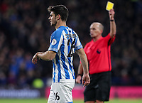 Huddersfield Town's Christopher Schindler is shown a yellow card by referee Mike Dean for a foul on Burnley's Chris Wood (not shown) <br /> <br /> Photographer Andrew Kearns/CameraSport<br /> <br /> The Premier League - Huddersfield Town v Burnley - Wednesday 2nd January 2019 - John Smith's Stadium - Huddersfield<br /> <br /> World Copyright © 2019 CameraSport. All rights reserved. 43 Linden Ave. Countesthorpe. Leicester. England. LE8 5PG - Tel: +44 (0) 116 277 4147 - admin@camerasport.com - www.camerasport.com
