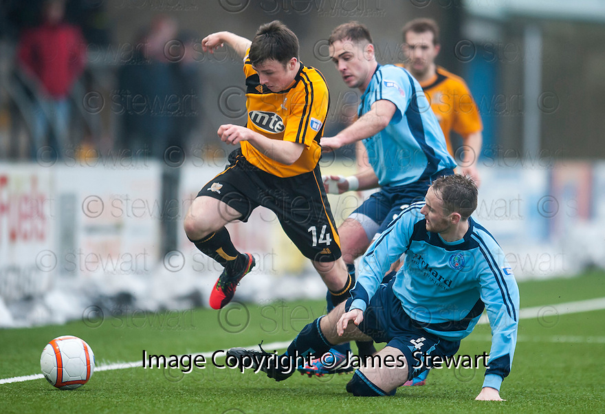 """Alloa""""s Calum Gallagher is challenged by Forfar's Michael Bolochoweckyj."""