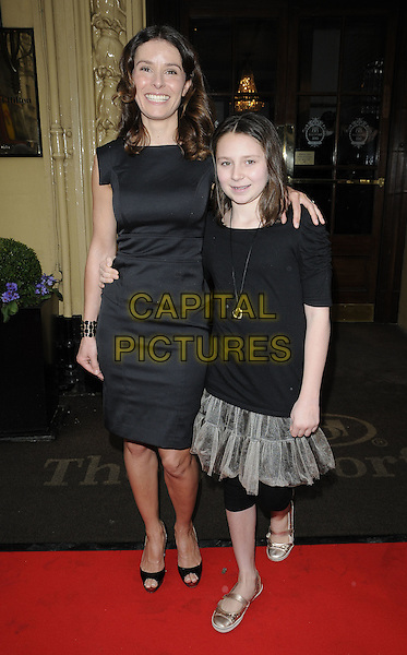 TANA RAMSAY & daughter Megan .Tesco Magazine Mum Of The Year .Awards 2010, held at The Waldorf Hilton Hotel, Aldwych, London, England, UK,.February 28th 2010..Arrivals full length black dress hand on hip cuff bracelet open peep toe shoes platform arm around shoulder family child kid mother mom smiling .CAP/CAN.©Can Nguyen/Capital Pictures