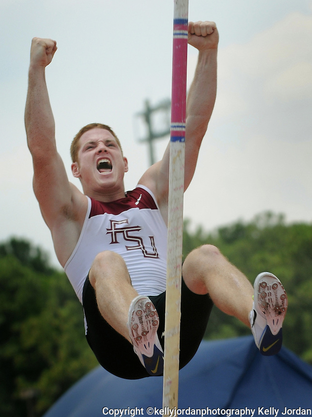 Kelly.Jordan@jacksonville.com--052612--Andrew LaHaye, of Florida State celebrates on the way down after he cleared the bar at 17 ft 3 1/2 inches in the pole vault to earn a spot at the National Championships during the NCAA Division 1 2012 Outdoor Track & Field Championships-East Preliminary at the University of North Florida in Jacksonville, Florida Saturday May 26, 2012.(The Florida Times-Union, Kelly Jordan)