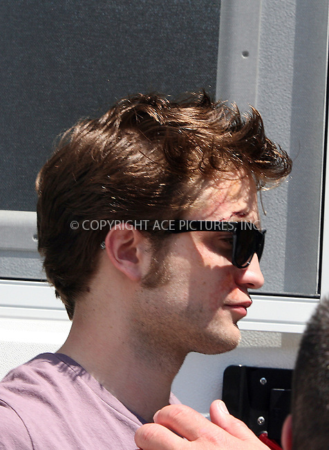 WWW.ACEPIXS.COM ************....June 30 2009, New York City....Actor Robert Pattinson looks battered and bruised as he leaves his trailer on 5th Avenue whilst getting ready to shoot a scene fo the new movie 'Remember me' on June 30 2009 in New York City....Please byline: PHILIP VAUGHAN - ACEPIXS.COM.. *** ***  ..Ace Pictures, Inc:  ..tel: (646) 769 0430..e-mail: info@acepixs.com..web: http://www.acepixs.com