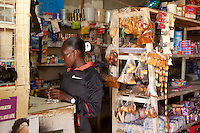 Elite Kenya woman marathon runner Florence Kiplagat stops at a small shop before  a training run outside Eldoret, Kenya.