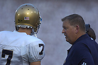 08 September 2007:  Notre Dame coach Charlie Weis talks with QB Jimmy Clausen (7).  The Penn State Nittany Lions defeated the Notre Dame Fighting Irish 31-10 September 8, 2007 at Beaver Stadium in State College, PA..