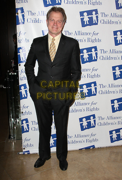 STEVEN COLLINS.Attending The Alliance for Children's Rights held At The Beverly Hilton Hotel, Beverly Hills, California, USA,.10th February 2010..full length  black suit jacket coat yellow shirt tie .CAP/ADM/KB. ©Kevan Brooks/AdMedia/Capital Pictures..