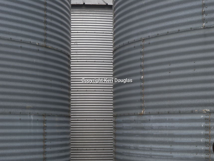 Steel blue farm grain containers