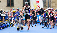 11 SEP 2010 - BUDAPEST, HUN - Jan Frodeno entres transition at the end of the bike during the 2010 Elite Mens ITU World Championship Series Triathlon final (PHOTO (C) NIGEL FARROW)