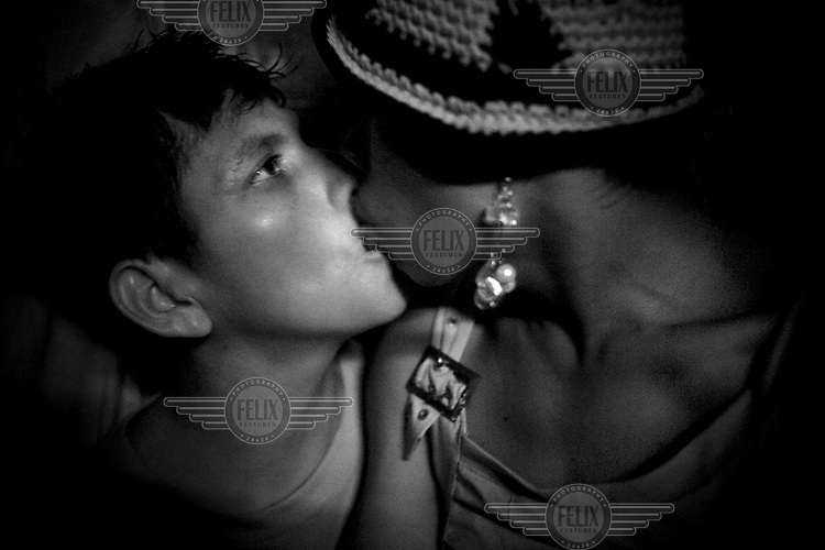 Two people kiss in la Mariposa community in Iquitos.