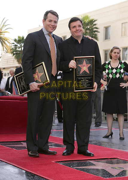 MATTHEW BRODERICK & NATHAN LANE.At the Star Ceremony on the Hollywood Walk of Fame Honoring Matthew Broderick and Nathan Lane, Hollywood, California..January 9th, 2006.Photo: William Scott/AdMedia/Capital Pictures.Ref: WS/ADM.full length plaque black suits.www.capitalpictures.com.sales@capitalpictures.com.© Capital Pictures.