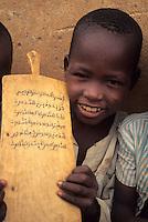 Zinder, Niger, Africa - Hausa Boy with Koranic Prayer Board.