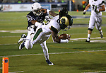 Colorado State's Dee Hart (10) dives past Nevada's Tere Calloway (30) into the end zone during the second half of an NCAA college football game in Reno, Nev., on Saturday, Oct. 11, 2014. Colorado State won 31-24. (AP Photo/Cathleen Allison)