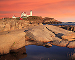 A Classic Lighthouse, Sunset Skies At The Nubble Light, A Pastoral New England Seascape, Cape Neddick, Maine, USA