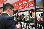 A visitor drinks Japanese traditional hard liquor Shochu at the 42nd International Food and Beverage Exhibition (FOODEX JAPAN 2017) in Makuhari Messe International Convention Complex on March 8, 2017, Chiba, Japan. About 3,282 companies from 77 nations are participating in the Asia's largest food and beverage trade show. This year organizers expect 77,000 visitors for the four-day event, which runs until March 10. (Photo by Rodrigo Reyes Marin/AFLO)