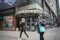 A Starbucks cafe near Times Square in New York seen on Sunday, February 1, 2015. (© Richard B. Levine)