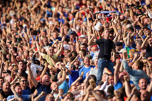 25.08.2013 Cardiff, Wales. Cardiff fans celebrate their teams equaliser during the second half of the Barclays Premier League football match between Cardiff City and Manchester City at Cardiff City Stadium.