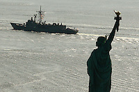 Australian Navy ships HMAS Sydney and HMAS Ballarat travel up New York Harbor onto the Hudson River past the Statue of Liberty and downtown Manhattan during a visit to New York City. . Trevor Collens / Photoshot