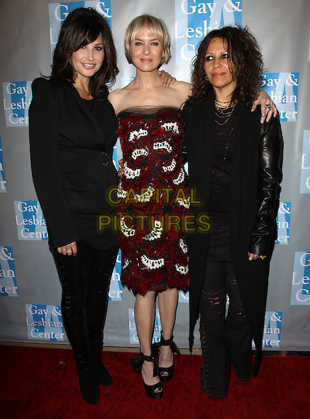 "GINA GERSHON, RENEE ZELLWEGER & LINDA PERRY .L.A. Gay & Lesbian Center's ""An Evening With Women -Inside held At The Beverly Hilton Hotel, Beverly Hills, California, USA, 1st May 2010. .full length black jacket red beaded white strapless dress leather arm around shoulder peep toe shoes sandals suit .CAP/ADM/FS.©Faye Sadou/AdMedia/Capital Pictures."