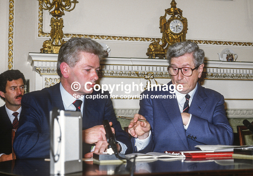 Press conference following signing of Anglo-Irish Agreement by Margaret Thatcher, Prime Minister, UK, and Garret Fitzgerald, Prime Minister, An Taoiseach, Rep of Ireland, at Hillsborough Castle, N Ireland, 15th November 1985. L to R: Peter Prendergast, Rep of Ireland Press Secretary, and Garret FitzGerald. 1985111505d.<br />