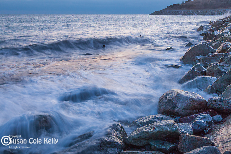 Sunrise paints the waves at Point Shirley Beach in Winthrop, MA, USA