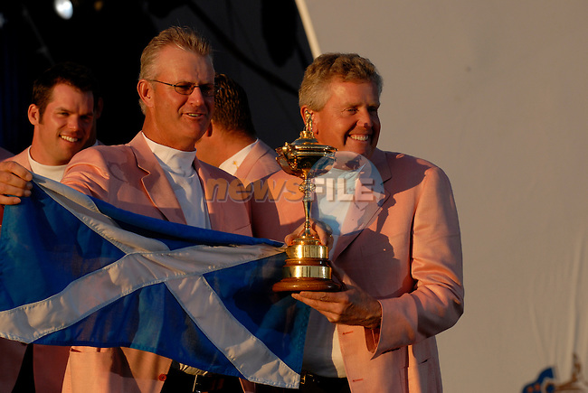 Scotish team members Sandy Lyle, assistant captain, and Colin Montgomerie, part of the victorious European Team, hold the Ryder Cup during the closing ceremony of the 2006 Ryder Cup at The K Club..Photo: Eoin Clarke/Newsfile.