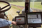 April 20, 2016. Rowland, North Carolina. <br />  Bo Stone points to the control panels of his tractor and planter. The machine are satellite guided, and utilize planting amps that Stone creates for each field. The cost for the tractor and planter is nearly $500,000.<br />  Bo Stone, age 44, runs a 2300 acre farm near the South Carolina border. After 5 generations of tobacco farming, Stone helped to move his family farm over to corn, wheat, soybeans, and strawberries 7 years ago. <br />  While his corn crop is entirely made up of stacked genetically modified strains of corn, Stone says he chose the varieties primarily for their yield characteristics, but having the ability to utilize their herbicide tolerant traits if a weed gets out of control is &quot;another tool in my toolbox&quot;.