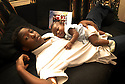 Demont Burton, 12 years old, takes care of four-month-old Jessica Burton at his home where 15 people live, New Orleans, Wednesday, Dec. 19, 2007...(AP Photo/Cheryl Gerber)