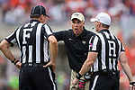 Wake Forest Demon Deacons head coach Dave Clawson voices his displeasure to a pair of officials during second quarter action against the Clemson Tigers at Memorial Stadium on October 7, 2017 in Clemson, South Carolina. The Tigers defeated the Demon Deacons 28-14.  (Brian Westerholt/Sports On Film)