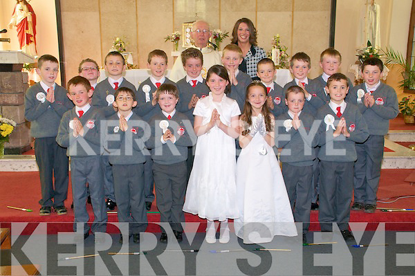 The boy and girls from Dromclough NS, Listowel who received their 1st Communion from Fr Gerald O'Connell at Irremore Church on Saturday...Front: Cillan Trant, Donal Hunt, Patrick Brosnsn,  Dervla Cronin, Erin Healy, Eoin Galvin & Aaron Smith...2nd Row: David O'Connell, Timmy Dillon, Liam Guiney,David Quinlan,  Daniel Walsh, Aidan Moloney, Thomas Dillon, Denis Quille, Tommy Kelly & Aodhan Behan. ..Back : Fr. Gerald O'Connell & Teacher Miss Sarah Jane Somers.