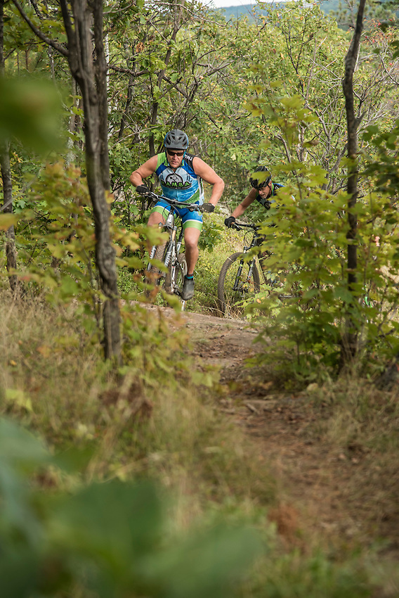 Mountain bikers on the Range Area Mountain Bike Association trails in Ishpeming, Michigan.