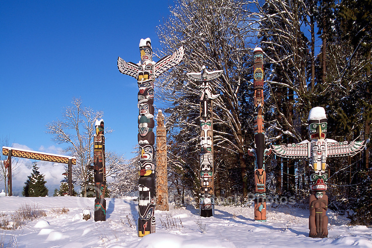 Snow Covered Totem Poles at Brockton Point in Stanley Park, Vancouver, BC, British Columbia, Canada, Winter