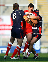 PICTURE BY VAUGHN RIDLEY/SWPIX.COM...Rugby League - International Friendly - England Knights v France - Leigh Sports Village, Leigh, England - 15/10/11…England's Joe Arundel is tackled by France's David Ferriol and Kane Bentley.