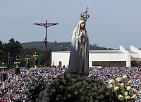 The statue of Our Lady of Fatima is carried by believers during the procession  of Fatima in central Portugal.