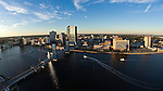 Downtown Jacksonville, Florida, view of the St. Johns River, Northband, Main Street Bridge at dusk - helicopter aerial