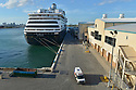 FORT LAUDERDALE, FL - April 02: Passengers are transported in an ambulance from the Holland America Line Inc. Zaandam cruise ship at Port Everglade in Florida on April 02, 2020 in Fort lauderdale, Florida. The Holland America cruise line ship had been at sea for the past 19 days after South American ports denied their entry due to the Coronavirus outbreak. Reports indicated that two of four people that died aboard the Zaandam had tested positive for COVID-19. Those passengers that are fit for travel in accordance with guidelines from the U.S. Centers for Disease Control will be permitted to disembark.   ( Photo by Johnny Louis / jlnphotography.com )