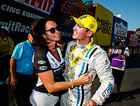 Sep 17, 2017; Concord, NC, USA; NHRA pro stock driver Tanner Gray celebrates with mother Amber Gray after winning the Carolina Nationals at zMax Dragway. Mandatory Credit: Mark J. Rebilas-USA TODAY Sports