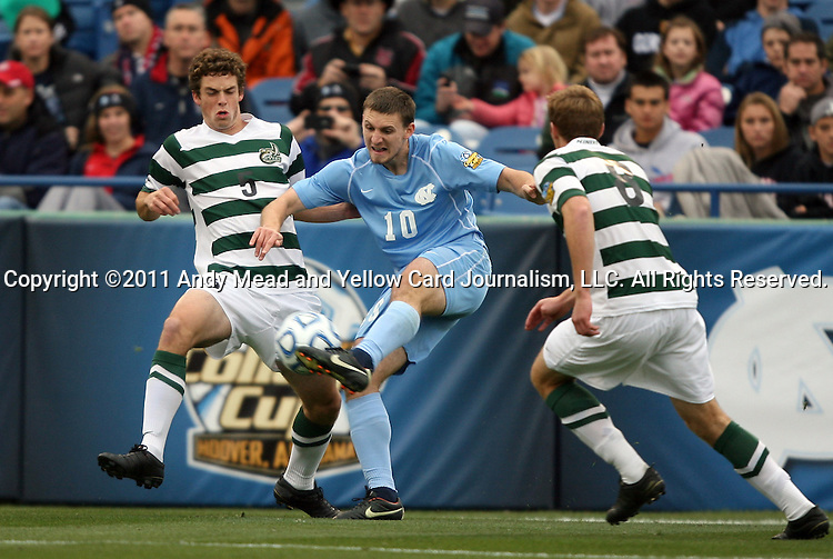 11 December 2011: North Carolina's Billy Schuler (10) is defended by UNCC's Thomas Allen (5) and Aidan Kirkbridge (ENG) (8). The University of North Carolina Tar Heels defeated the University of North Carolina Charlotte 49ers 1-0 at Regions Park in Hoover, Alabama in the NCAA Division I Men's Soccer College Cup Final.