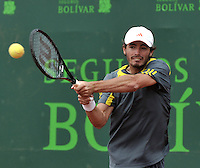 BOGOTA - COLOMBIA -05 -11-2013: Juan I. Londero, tenista de Argentina devuelve la bola a Santiago Giraldo, tenista colombiano, durante partido de la primera ronda del Seguros Bolivar Open en el Club Campestre el Rancho de la ciudad de Bogota. / Juan I. Londero, Argentina tennis player returns the ball to Santiago Giraldo Colombian tennis player during a match for the first round of the Seguros Bolivar Open in the Club Campestre El Rancho in Bogota city.Photo: VizzorImage  / Luis Ramirez / Staff.