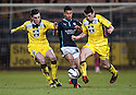 Dundee's Philip Roberts is crowed out by St Mirren's John McGinn and Sean Kelly.