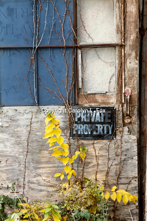 A private property sign is on an old door on one of the old, historic dairy barns at Longview Farms near Kansas City, Missouri.