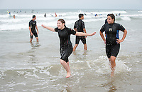 Incoming Occidental College students participate in Oxy Engage, in which they can explore the Los Angeles area before orientation. This group learned to surf at Manhattan Beach, Aug. 20, 2015.<br /> (Photo by Marc Campos, Occidental College Photographer)