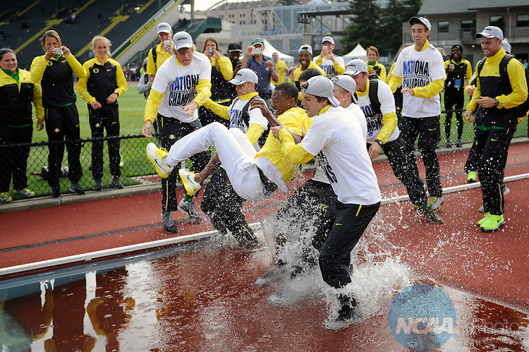 14 JUNE 2014: The University of Oregon men's outdoor track and field team celebrates its national championship by throwing head coach Robert Johnson during the Division I Men's and Women's Outdoor Track & Field Championships held at Hayward Field on the University of Oregon campus in Eugene, OR.   Chris Steppig/NCAA Photos
