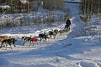 Saturday, February 24th, Knik, Alaska.  Jr. Iditarod musher Megan Hedgecoke on the trail shortly after leaving the Knik start