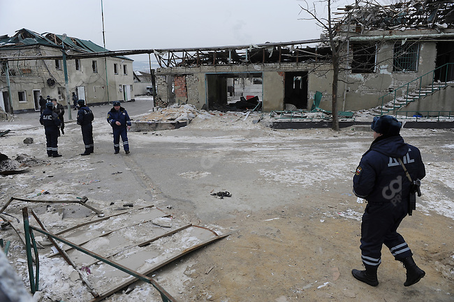 Policemen walked through the yard of a police station in Mahachkala, the Dagestani capital, still seriously damaged from a suicide attack on 6 January 2010 which killed 7 policemen and wounded many others, the most dramatic in a series of attacks on the republic's police forces by terrorists. January 28, 2010