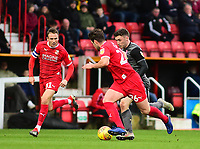 Lincoln City's Shay McCartan gets between Swindon Town's Matthew Taylor, left, and Dion Conroy<br /> <br /> Photographer Andrew Vaughan/CameraSport<br /> <br /> The EFL Sky Bet League Two - Swindon Town v Lincoln City - Saturday 12th January 2019 - County Ground - Swindon<br /> <br /> World Copyright &copy; 2019 CameraSport. All rights reserved. 43 Linden Ave. Countesthorpe. Leicester. England. LE8 5PG - Tel: +44 (0) 116 277 4147 - admin@camerasport.com - www.camerasport.com
